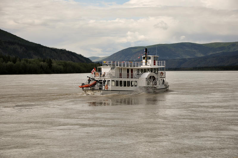 Vintage paddle boat. This vintage paddle boat carries passengers on historic tours of the wild Yukon River stock images