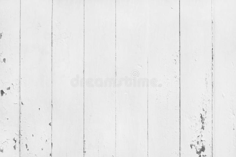 Vintage painted wooden background with cracked and peeled, abstract white color wall texture in natural pattern for design royalty free stock photography
