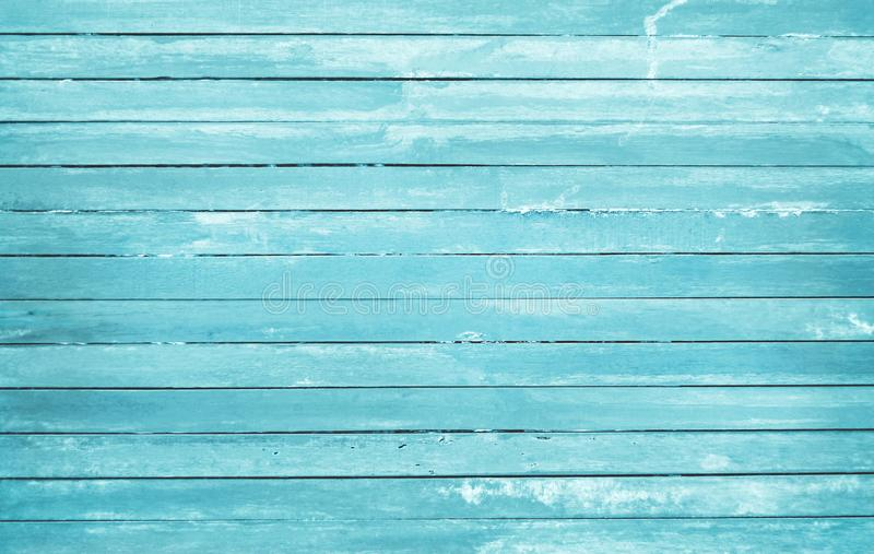 Vintage painted wooden wall background, texture of blue pastel color with natural patterns for design art work.  stock image