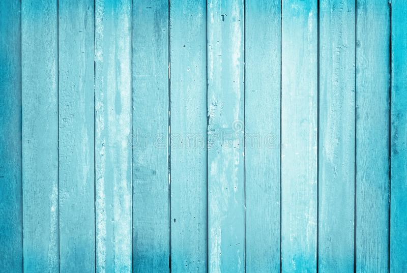 Vintage painted wooden wall background, texture of blue pastel color with natural patterns for design art work.  royalty free stock image