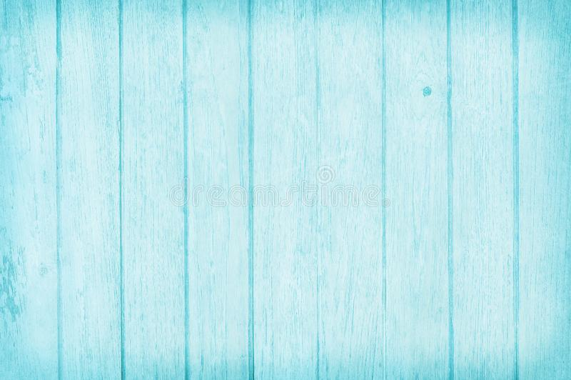 Vintage painted wooden wall background, texture of blue pastel color with natural patterns for design art work.  stock photo
