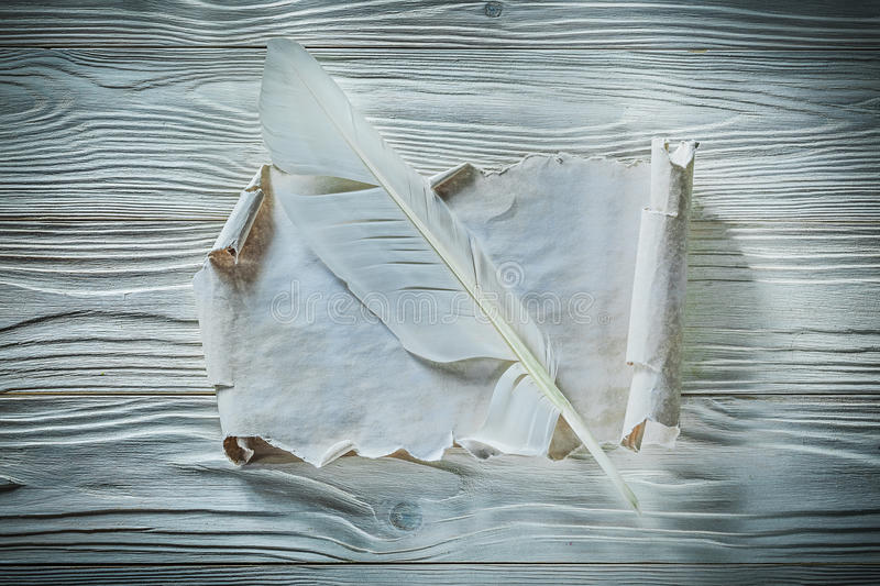 Vintage paper roll quill on wooden board.  stock images