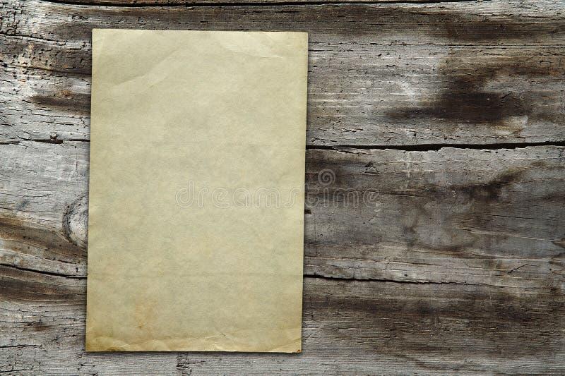 Vintage paper on wood texture stock photo
