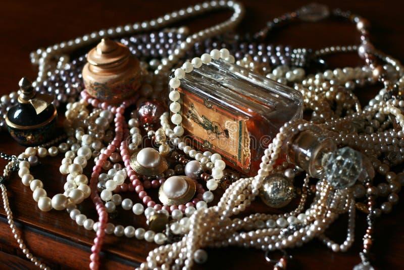 Vintage pearls treasure, old perfume bottle royalty free stock photo