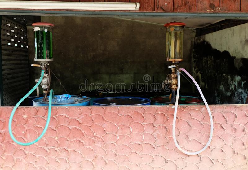 Vintage Petrol pump oil barrel, Rotary Manual hand Oil Pump In the countryside stock images