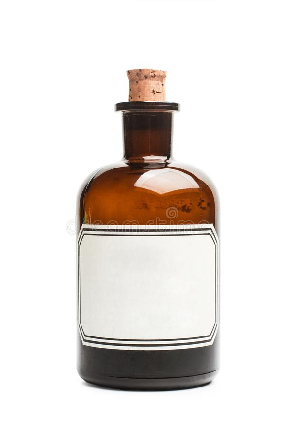 A vintage pharmacy bottle with a cork and a white label royalty free stock photos