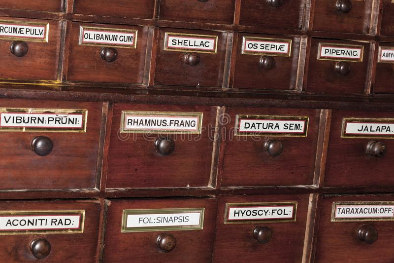 Vintage pharmacy wooden drawers royalty free stock images