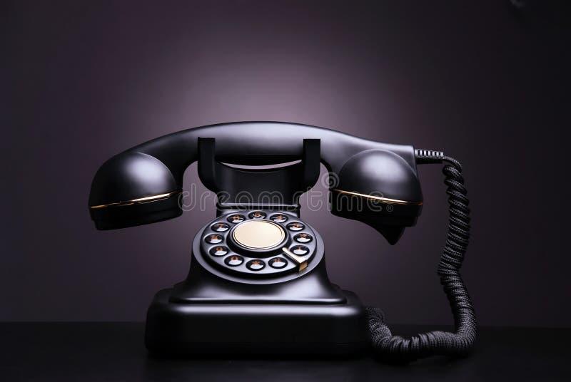 Vintage phone. On dark background royalty free stock photo