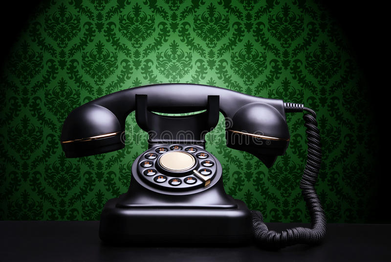 Vintage phone. On dark background stock photos