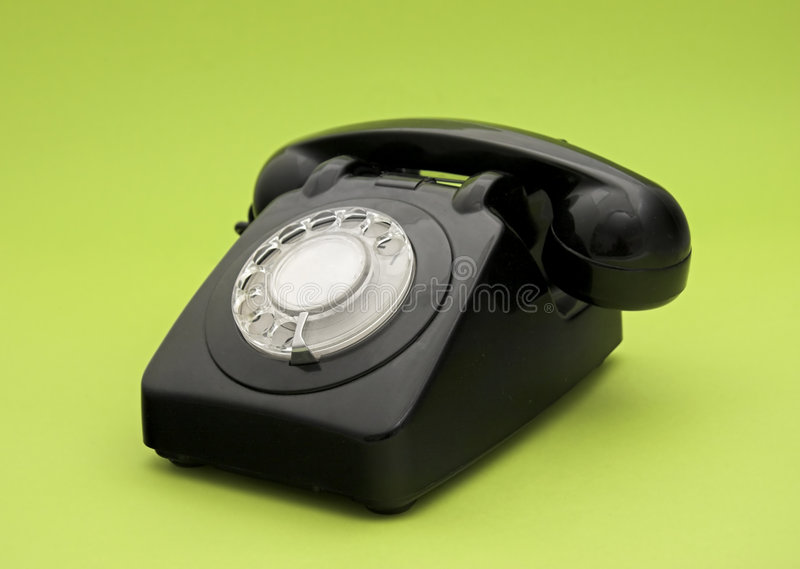 Vintage phone. In a green background stock image