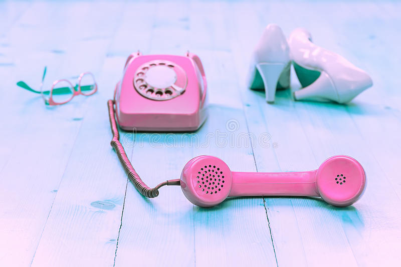 Vintage phone, shoes and glasses stock image