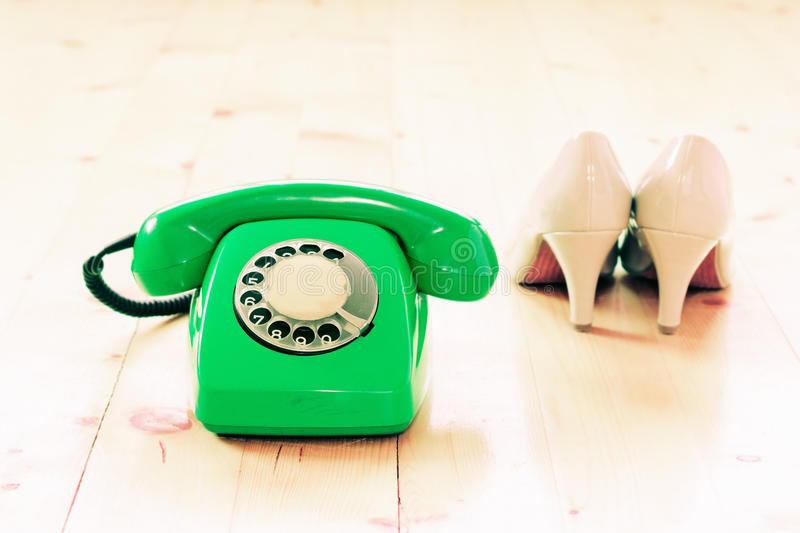 Vintage phone and shoes royalty free stock photo