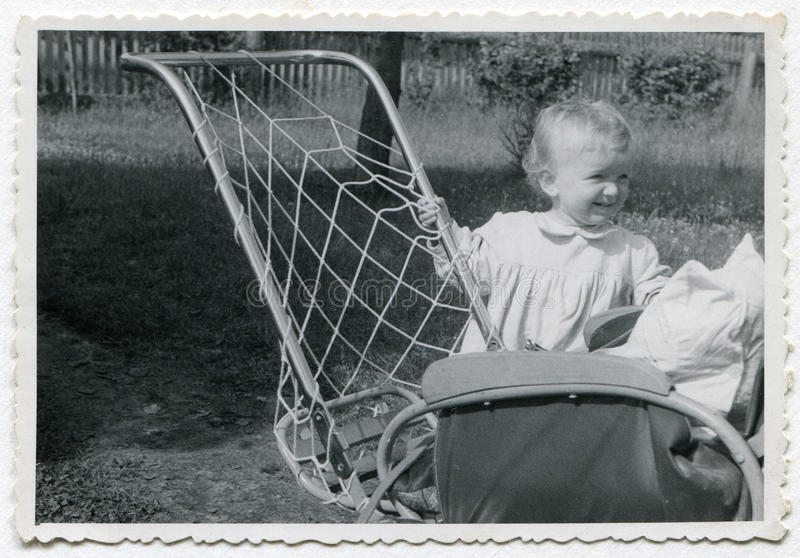 Vintage photo of baby girl royalty free stock photo