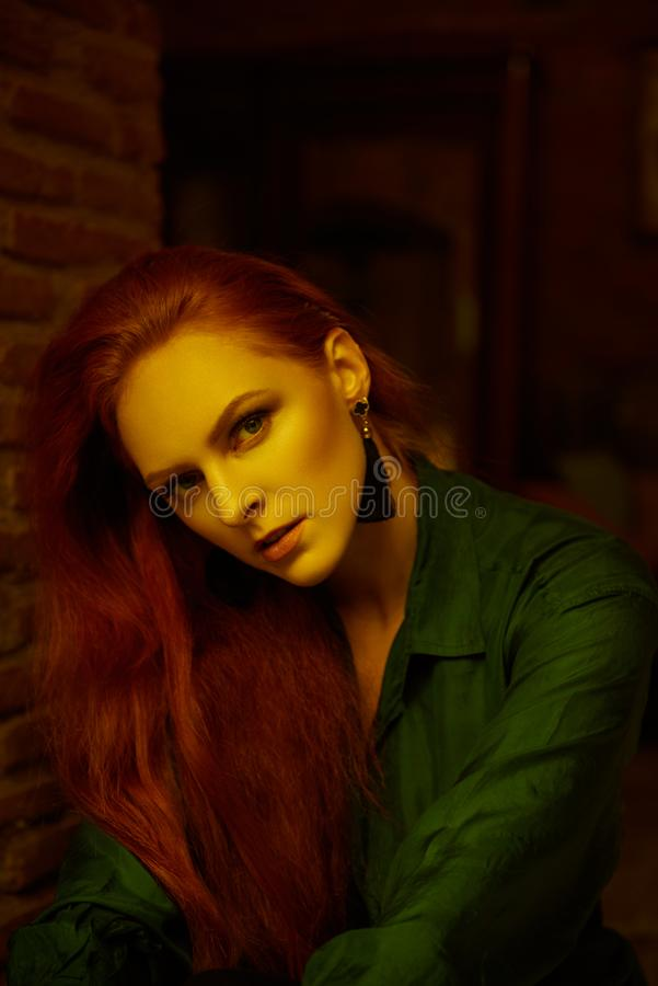 Vintage photo of Beautiful red haired young woman posing in old loft apartment in Tbilisi. Close up portrait Ginger lady posing in loft apartment in Tbilisi. She stock images