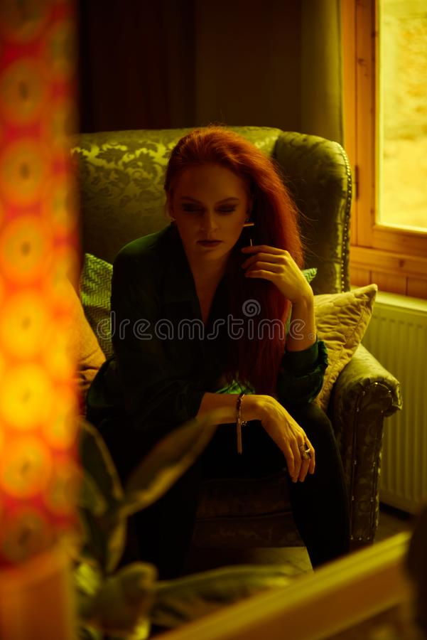 Vintage photo of Beautiful red haired young woman posing in old loft apartment in Tbilisi. Mirror reflection of Ginger lady posing in loft apartment in Tbilis stock photos