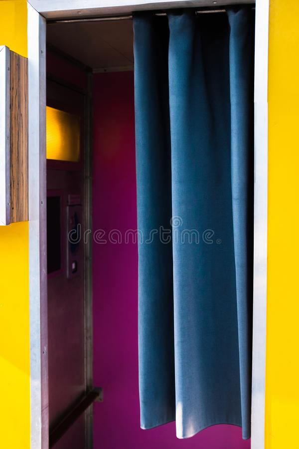Vibrant Retro Photo Booth in Yellow, Blue and Magenta royalty free stock images