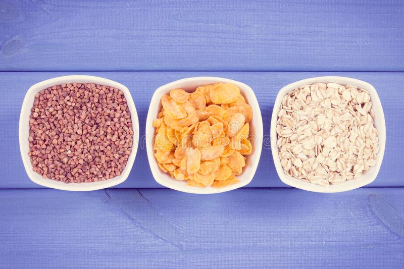 Vintage photo, Buckwheat, cornflakes and oatmeal as source minerals, vitamin B2 and fiber, nutritious eating royalty free stock photography