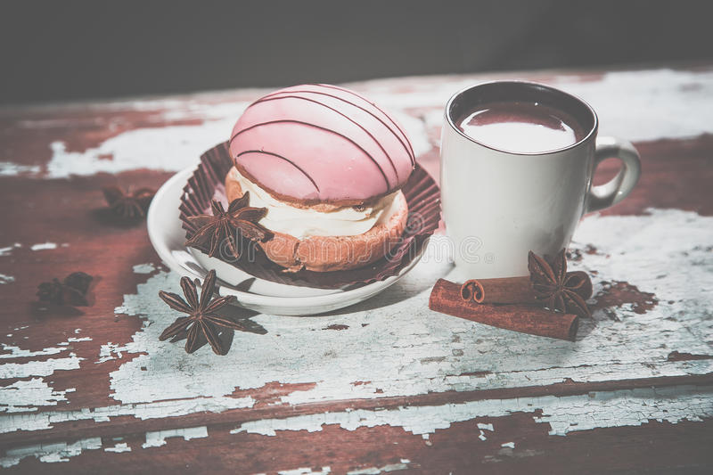 Vintage photo, cake with a cup of hot chocolate royalty free stock photo