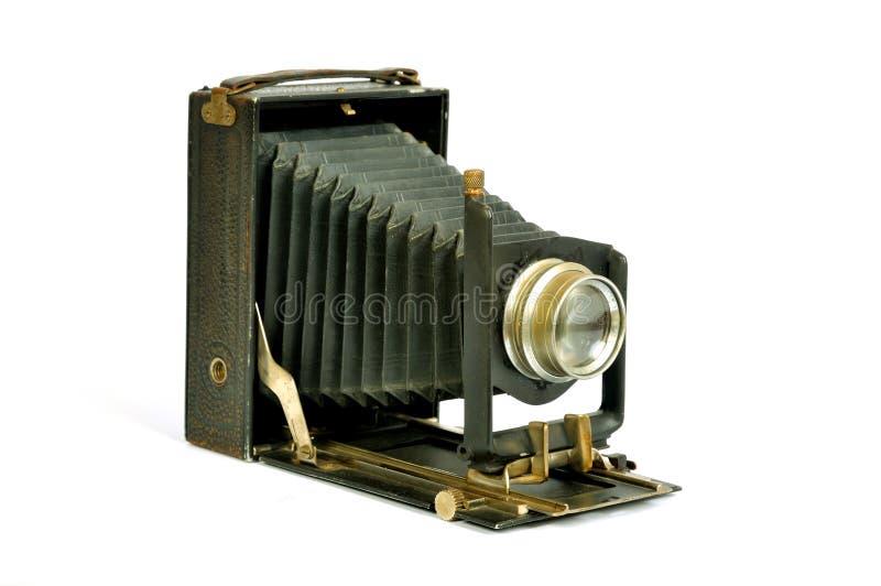 Vintage photo camera. Vintage bellows photo camera isolated on white royalty free stock image