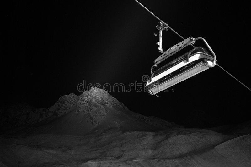 Vintage photo of a chairlift and mountain stock photos
