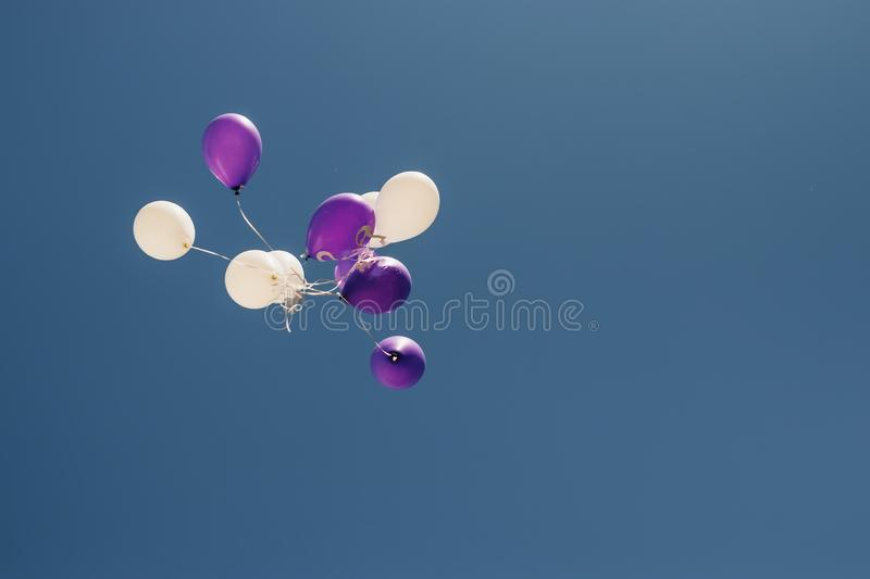 Vintage photo of colorful balloons on blue sky. Concept of love in summer, valentine, wedding and honeymoon stock images
