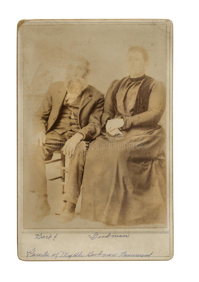 Vintage photo of couple seated for portrait. Photograph royalty free stock photo