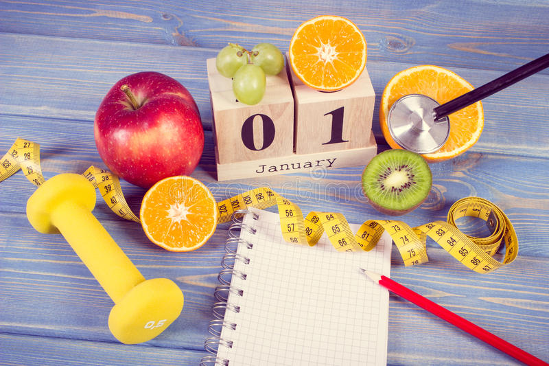 Vintage photo, Cube calendar, fruits, dumbbells and tape measure, new years resolutions royalty free stock photos