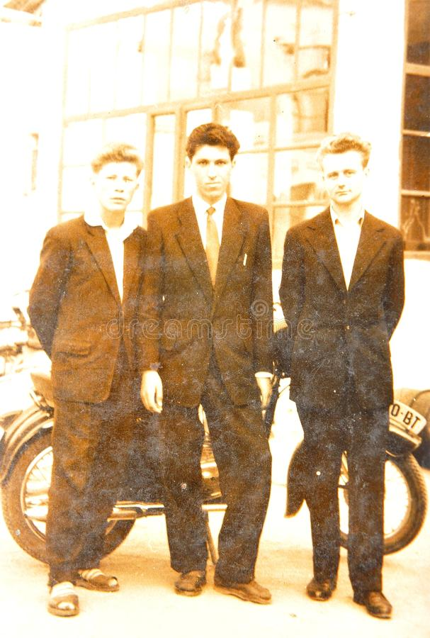 Vintage photo. Depicting group of young men royalty free stock photo