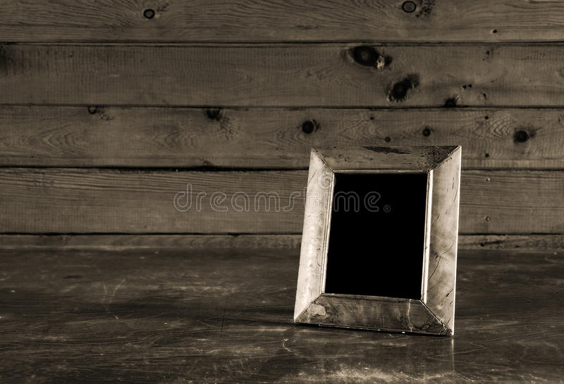 Vintage photo-frame on old table royalty free stock images