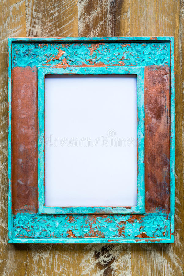 Vintage photo frame over wood background with empty white canvas royalty free stock photo