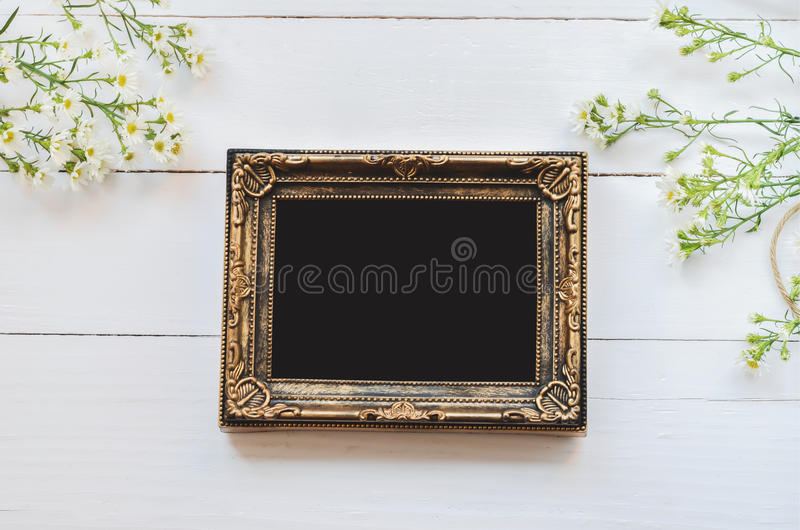 Vintage photo frame on wooden background royalty free stock images