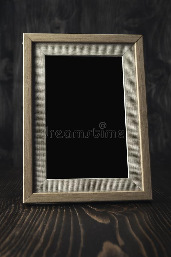 Vintage photo frame on wooden table. Close up stock photo