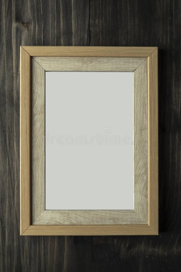 Vintage photo frame on wooden table. Close up royalty free stock photography