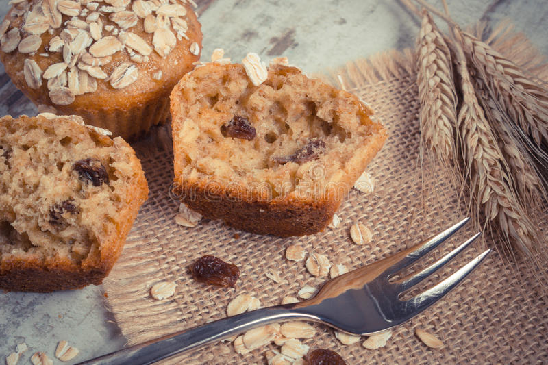 Vintage photo, Fresh muffins with oatmeal baked with wholemeal flour and ears of rye grain, delicious healthy dessert royalty free stock photos
