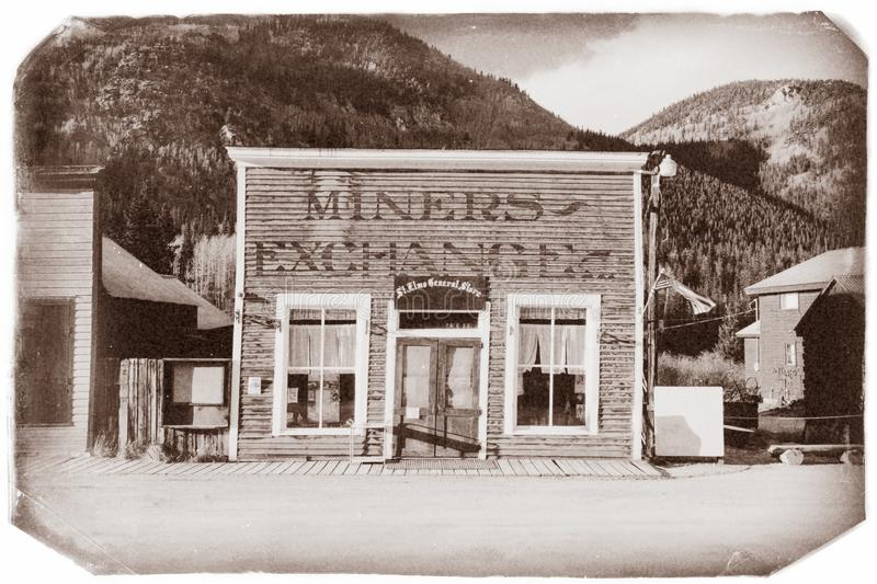 Vintage Photo of an old General store with miners exchange in old western town. In the middle of mountains royalty free stock images