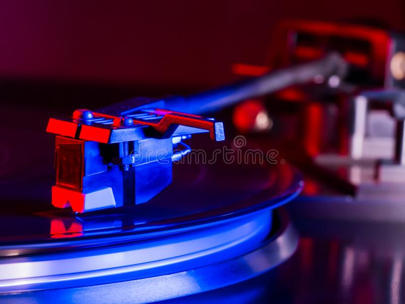 Vintage photo of Old Gramophone, playing a music. Neon light. Cinemagraph, retro record vinyl player. Record on royalty free stock photography