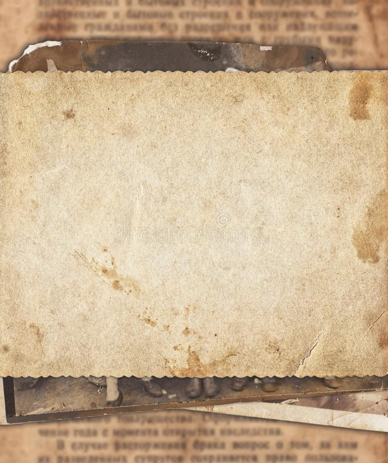 Vintage photo paper on old newspaper texture background royalty free stock images