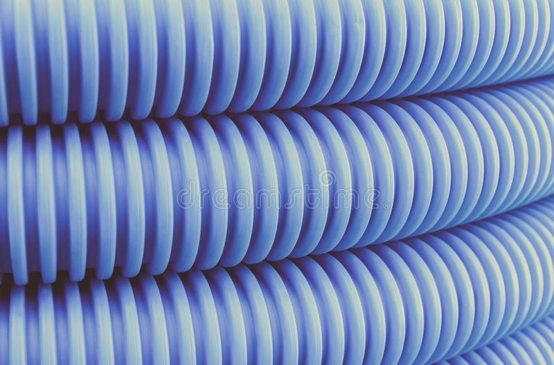 Vintage photo, Plastic corrugated pipe for installation royalty free stock images