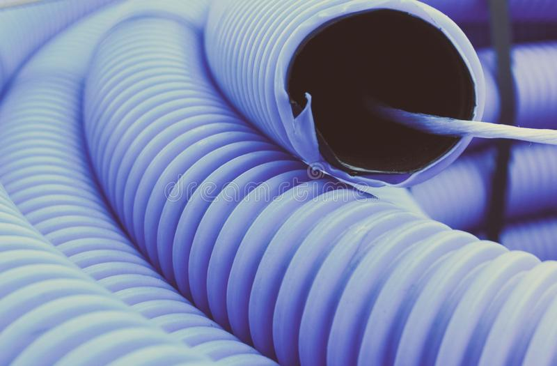 Vintage photo, Plastic corrugated pipe for installation stock photos