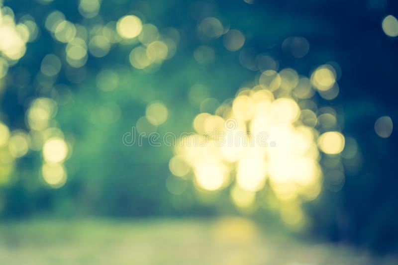 Vintage photo of summertime bokeh background. Abstract photo of defocused summer forest, photo useful as background. Vintage mood effect royalty free stock photo