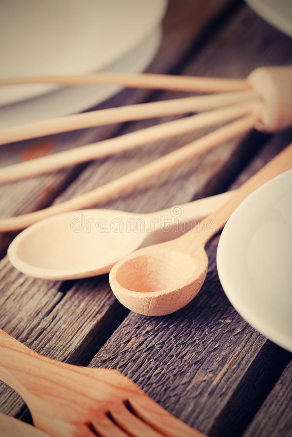 Vintage photo of wooden cutlery on old table stock photo