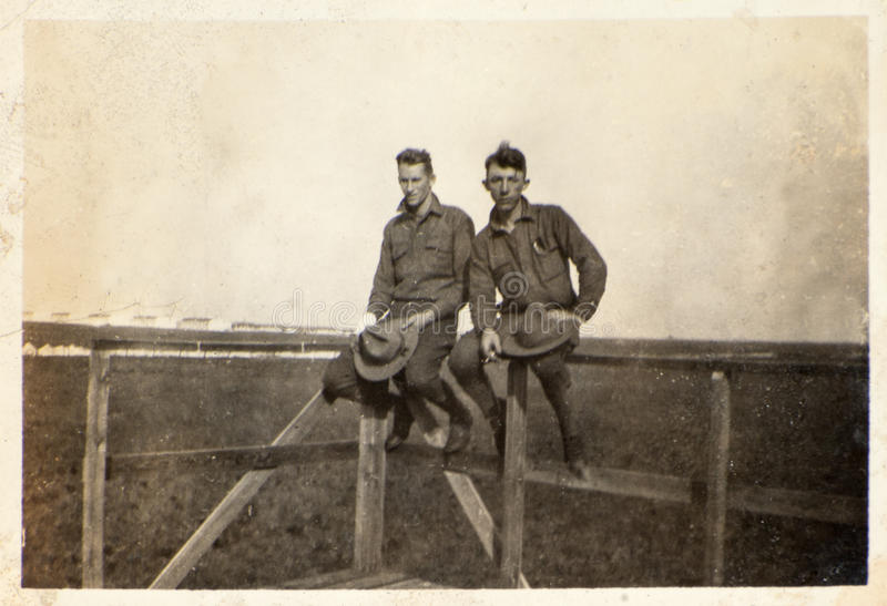 Vintage Photograph WWI Army Soldiers. Two American Yanks from World War One pose together in camp. The WWI army soldiers are in their uniforms in this vintage stock images