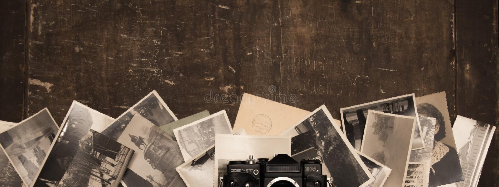 Vintage photos on the old background, with a camera zenith royalty free stock photos