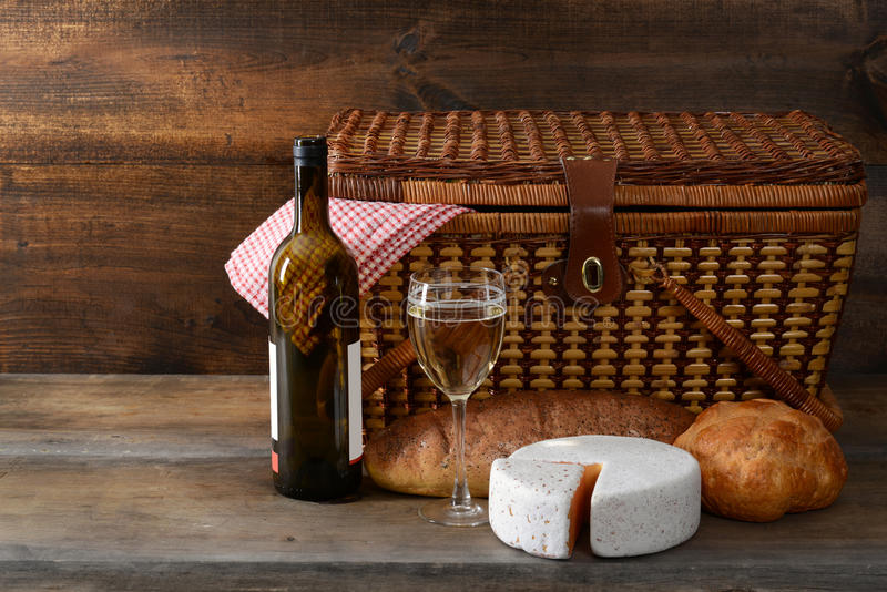 Vintage picnic basket with wine royalty free stock image