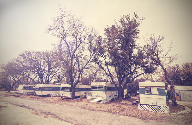 Vintage picture of american house trailers estate, USA countryside. royalty free stock images