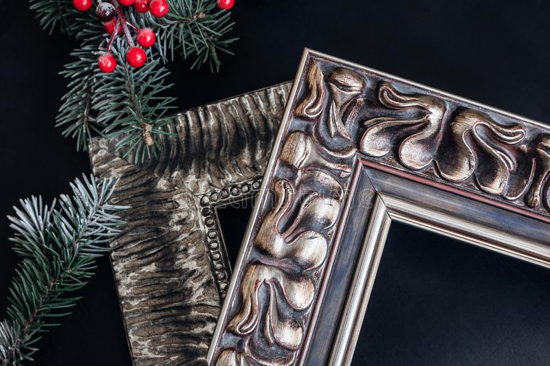 Two wooden picture frames on black background. Christmas decor. stock photography