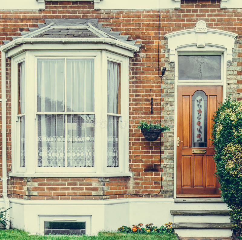 Vintage picture of front of typical English house stock photos