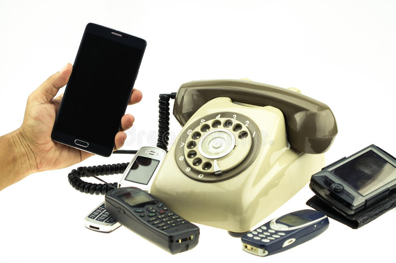 Vintage picture style of New smart phone with old telephone on white background. New communication technology.  stock photography
