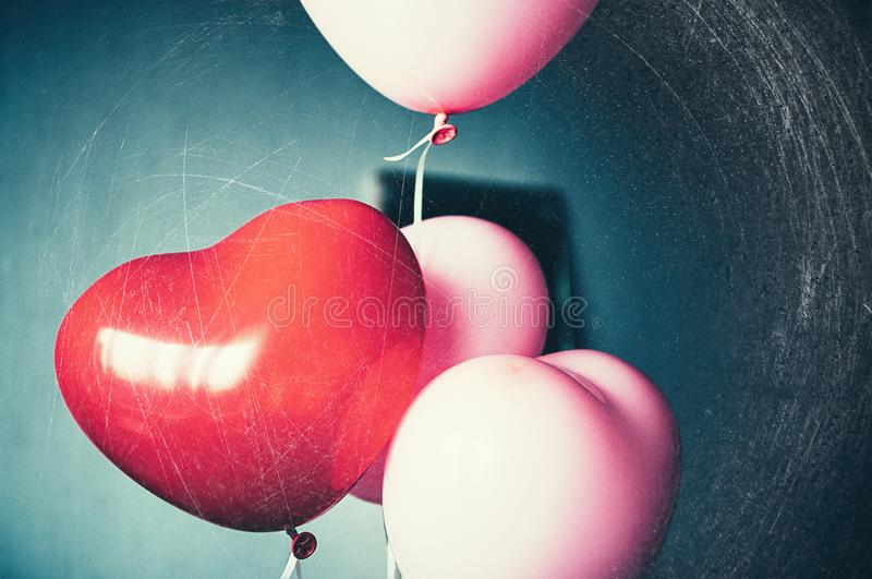 Vintage pink heart shaped balloons retro stock images