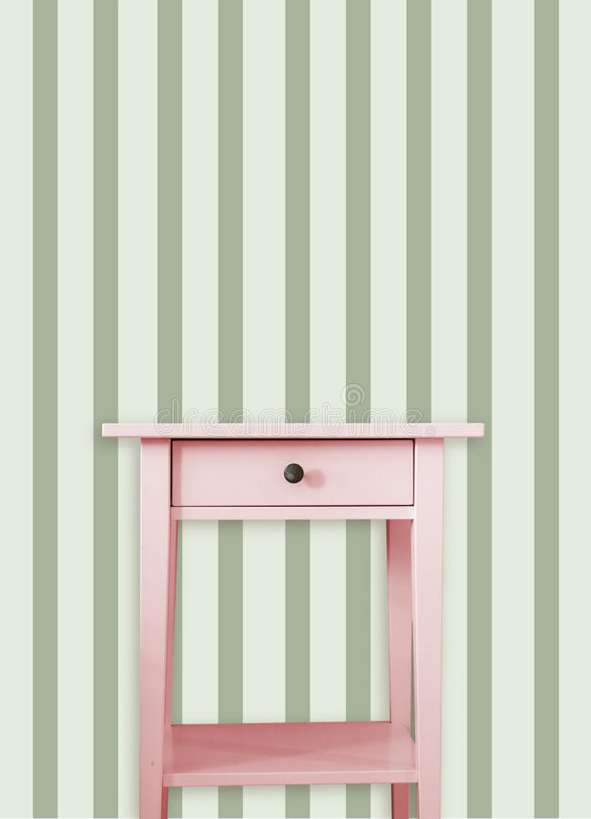 Vintage pink wooden chest drawer near vintage dots wall.  stock illustration